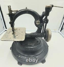 Antique WILCOX & GIBBS Tabletop Sewing Machine with Heavy Base. Turns Freely